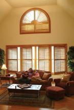 Plantation Shutters With Divider Rails and Tilt Rods. Arch Topped Plantation Shutter Window Treatment.